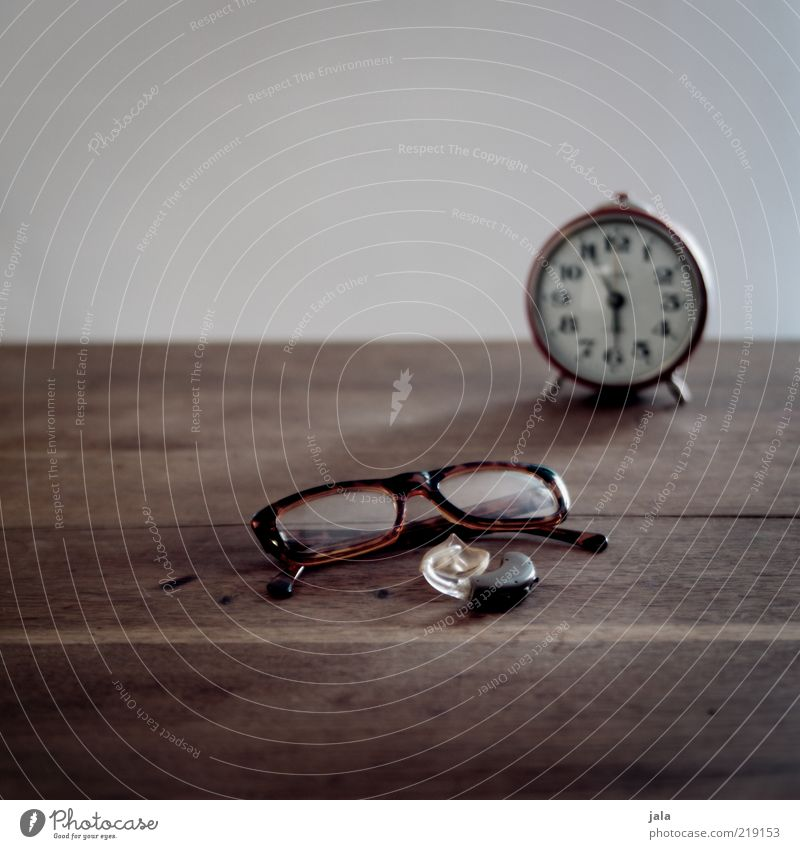 it's time... Wood Brown Gray Eyeglasses Hearing aid Alarm clock Time Senses Colour photo Interior shot Copy Space top Neutral Background Day Deserted Lie Part