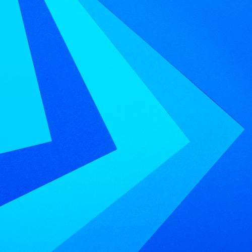 Sheets of paper in different shades of blue lie on top of each other Paper Line Arrow Stripe Esthetic Sharp-edged Blue Conscientiously Orderliness Design Colour