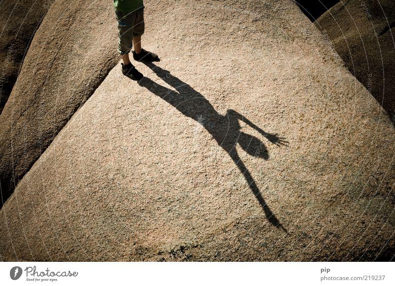 shadow cast Human being Boy (child) Feet Legs 1 Summer Beautiful weather Rock Stone Stand Happy Brown Joy Happiness Unwavering Curiosity Granite Sign language