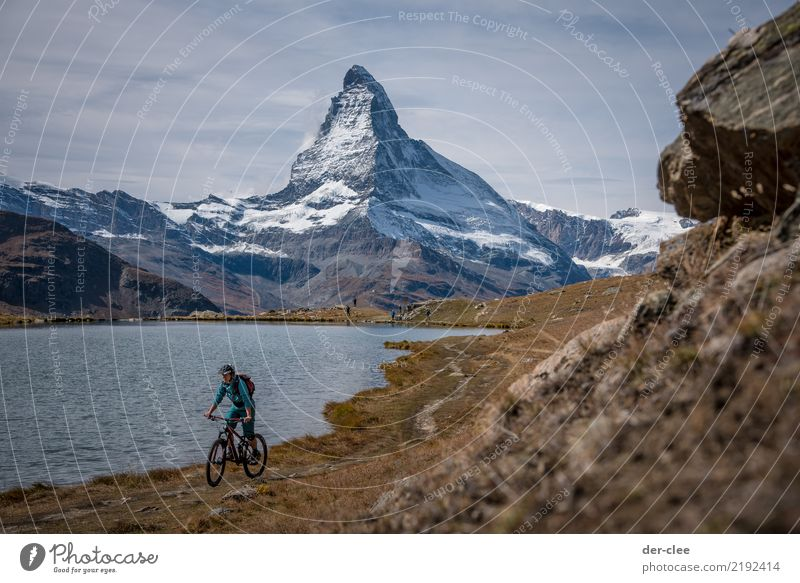 MTB in front of the Matterhorn Sports Fitness Sports Training Cycling Mountain bike Feminine Body 1 Human being Environment Nature Plant Elements Earth Water