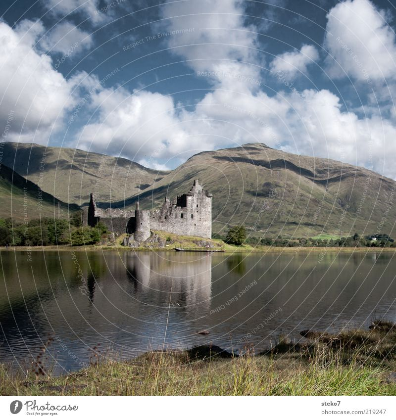 Clouds Loneliness Mountain Lake Transience Derelict Ruin Lakeside Mirror image Scotland Europe Highlands Clouds in the sky Water reflection Castle ruin
