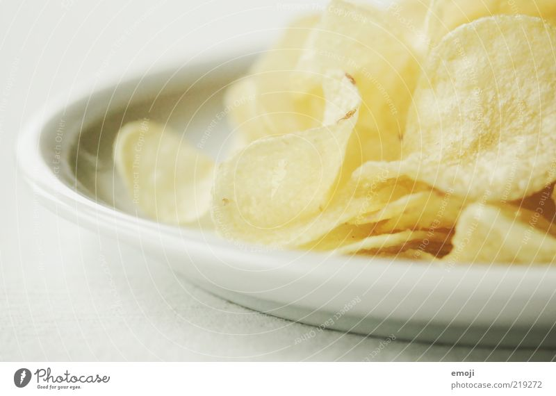 CHCHKZKKCHCH Nutrition Fast food Finger food Plate Yellow White Crisps Salty Fat Unhealthy Colour photo Neutral Background Shallow depth of field Detail