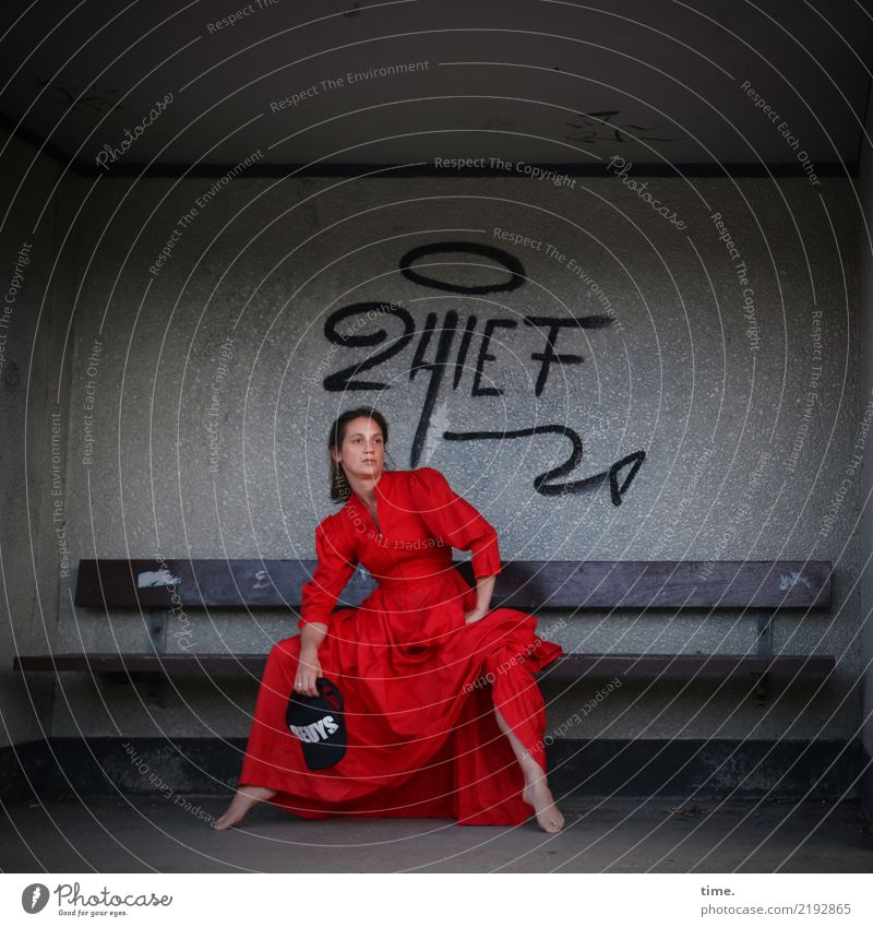 lil't Feminine Woman Adults 1 Human being Actor Hut Building Wall (barrier) Wall (building) Dress Cap Brunette Long-haired Sign Characters Graffiti Bench