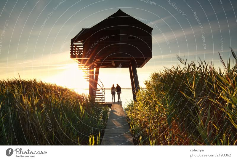 couple by wooden observing tower at sunset Summer Sun Ocean Couple Landscape Sky Coast Lake Building Architecture Lanes & trails Together Serene Relationship