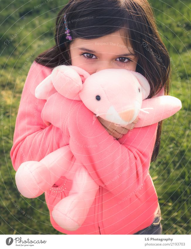 Girl holding stuffy Happy Playing Sun Easter Human being Woman Adults Hand Grass Toys Doll Teddy bear Embrace Cute Clean Green Pink Emotions Safety
