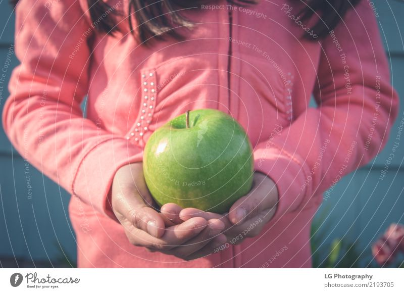 Girl holding green apple Fruit Apple Eating Woman Adults Hand Fresh Cute Green Pink Partially visible elementary age food healthy Horizontal kids little girls
