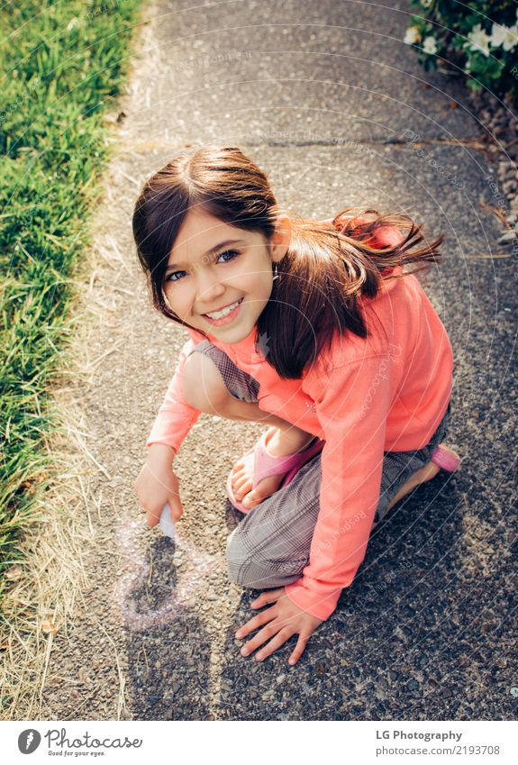 Young girl with brown hair is playing outside. Happy Beautiful Playing Summer Sun Human being Woman Adults Art Flower Graffiti Cute Pink Safety Colour artistic