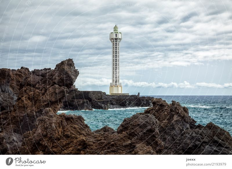 Futuristic lighthouse Faro de Punta Lava with lava rocks Landscape Water Sky Horizon Beautiful weather Rock Waves coast Ocean Island La Palma Camino Las Hoyas