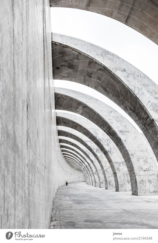 Modern exposed concrete structure, wall with arches and walkers harbour wall Protection Breakwater dam Architecture Manmade structures Breakwaters Concrete