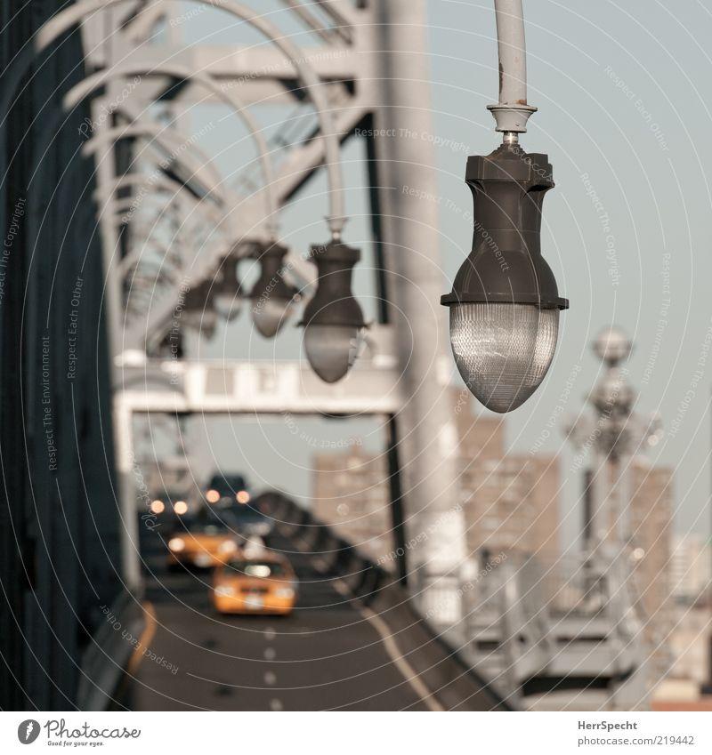 Crossing Williamsburg Bridge New York City East River Passenger traffic Motoring Street Car Brown Yellow Gray Perspective Lighting element Row Traffic lane