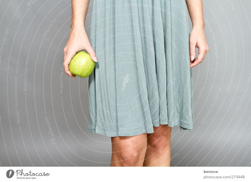 app Woman Human being Dress Apple Fruit Green To hold on Hand Fingers Legs Healthy Nutrition Diet Thin Life Diva Vegetarian diet Copy Space left Knee