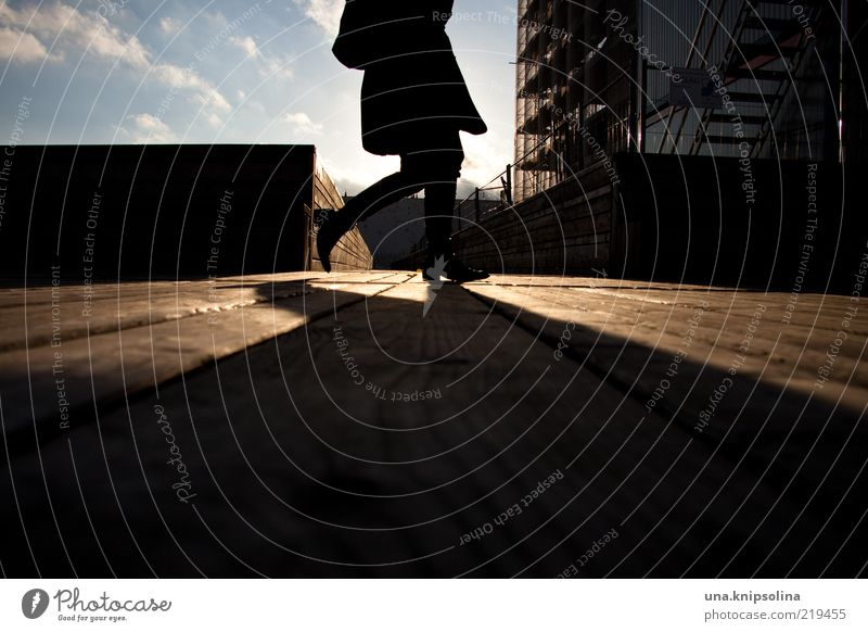 Human being Wood Bright Going Walking Illuminate Footbridge Haste Section of image Partially visible Anonymous In transit Pedestrian Headless Shadow play