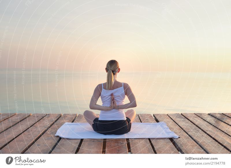 Young woman practising yoga by sea Woman Vacation & Travel Summer Ocean Relaxation Adults Copy Space Blonde Power Energy Wellness Serene Meditation Yoga Breathe