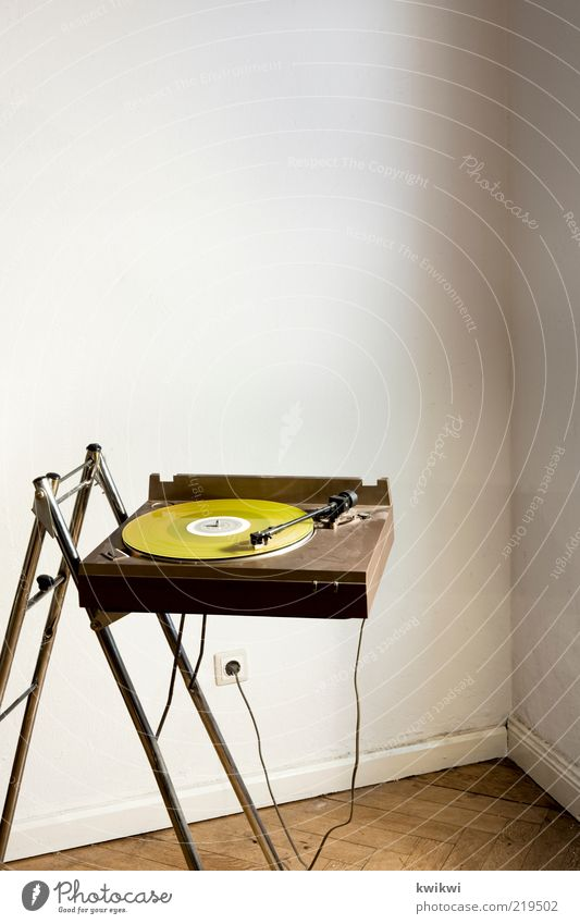 Yellow Interior design Music Brown Room Design Lifestyle Cable Retro Listening Disc jockey Seventies Record Entertainment Socket Electrical equipment