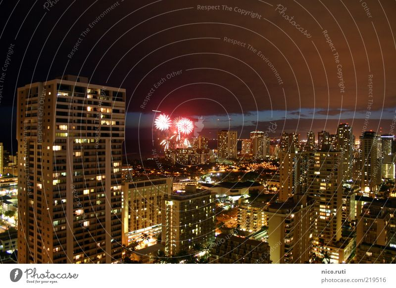 Pyrotechnics at eye level Honolulu Hawaii Town Capital city Skyline High-rise Hotel Facade Bright Emotions Calm Firecracker light pollution Long exposure Bang