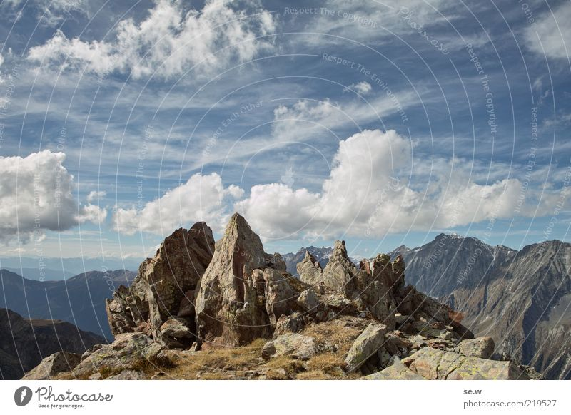 Sky Blue Summer Vacation & Travel Clouds Loneliness Far-off places Mountain Earth Brown Horizon Rock Alps Peak Vantage point Bizarre