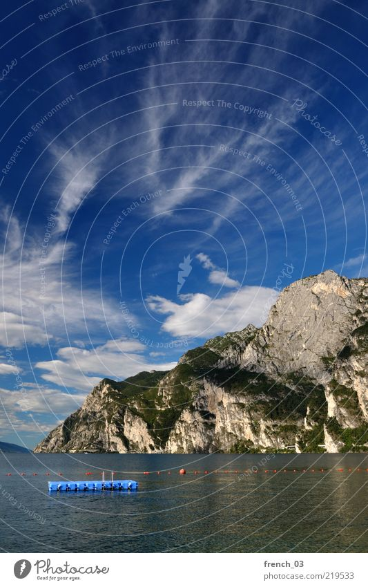 it doesn't stop Relaxation Calm Vacation & Travel Environment Water Sky Clouds Beautiful weather Mountain Dolomites Lake Lake Garda Riva del Garda Italy Blue