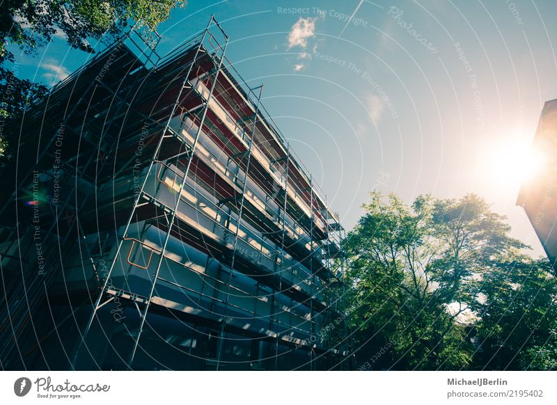 Scaffold at a house in bright sunshine Construction site Town House (Residential Structure) Manmade structures Building Architecture Facade Growth Luxury