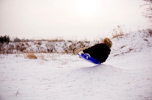 PANCAKE SLIDE Joy Leisure and hobbies Playing Winter Snow Human being Masculine Boy (child) Infancy 1 Environment Nature Landscape Sky Movement Sledding Skid