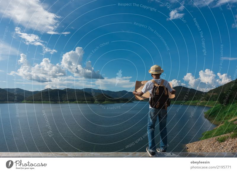 Young tourist boy looking a map stay alone at the mountain Child Nature Vacation & Travel Man Summer Town Mountain Adults Street Lifestyle Boy (child) Small