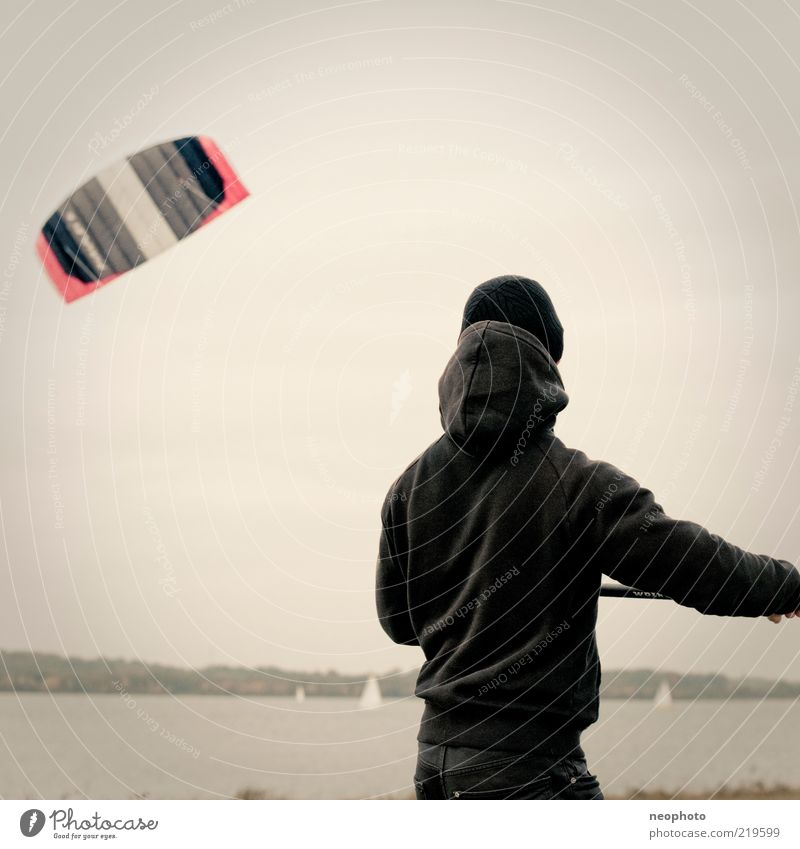 Human being Nature Autumn Sports Lake Wind Flying Leisure and hobbies Young man Cap Kite Kiting Glide Dexterity Toys Rear view