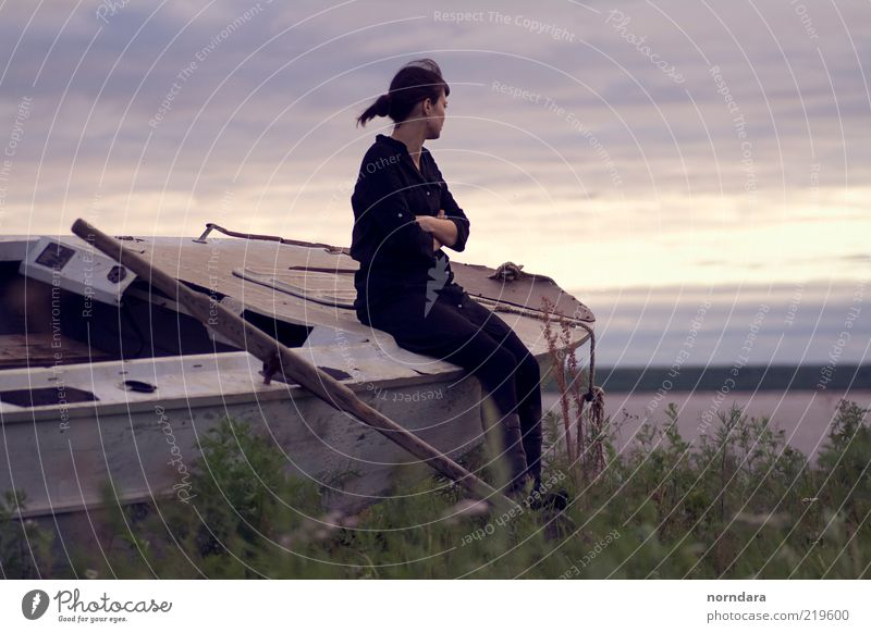 she and the boat. Woman Human being Sky Nature Youth (Young adults) Water Blue Plant Summer Adults Cold Landscape Grass Hair and hairstyles Dream Air