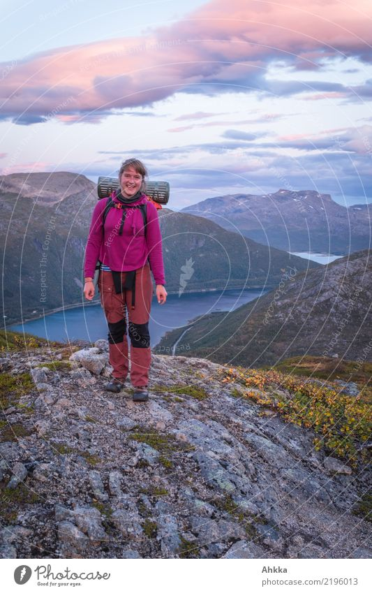 Young woman in front of Norwegian evening scenery Vacation & Travel Trip Adventure Hiking Youth (Young adults) Landscape Clouds Mountain Fjord Norway Lofotes