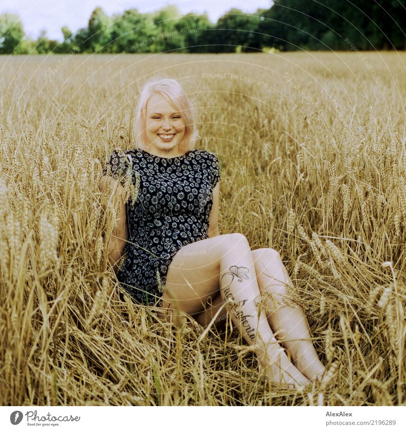 analogue portrait of a young woman sitting barefoot in a rye field in a summer dress and smiling already Life Well-being Young woman Youth (Young adults) Legs