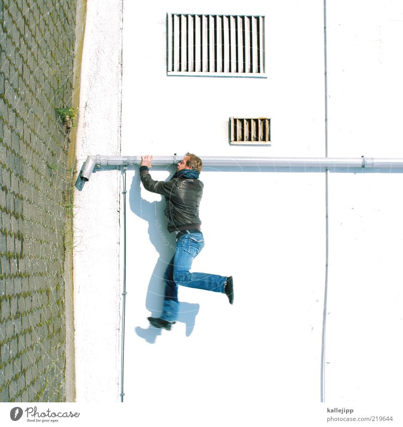 Human being Man House (Residential Structure) Adults Wall (building) Wall (barrier) Jump Facade Stop Jeans Climbing Jacket Rotate Leather Paving stone Conduit