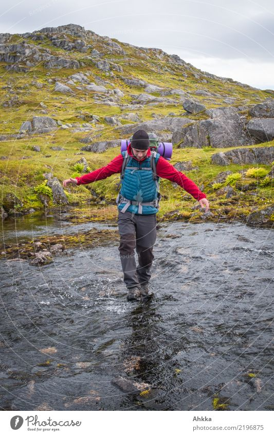Young man crosses a river Vacation & Travel Adventure Hiking Youth (Young adults) 1 Human being Nature Water River Norway Walking Authentic Infinity Natural
