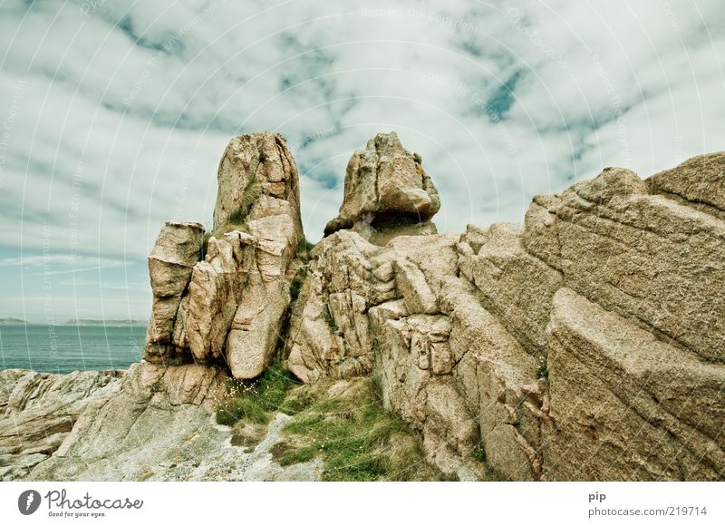 Nature Water Sky Ocean Summer Clouds Far-off places Grass Stone Coast Weather Rock Tall Fresh Firm Rock formation