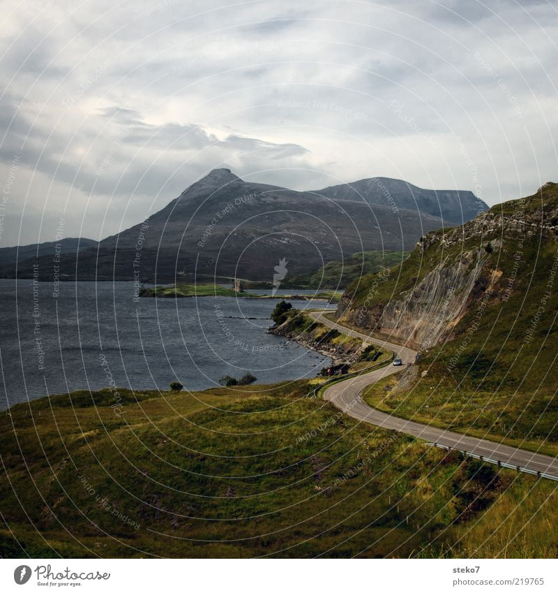 no picture of Scotland without ruins Mountain Peak Lakeside Ruin Coastal road Car Loneliness Freedom Vacation & Travel Curve Colour photo Copy Space top Castle