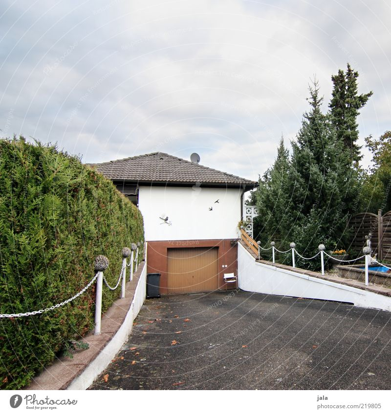 garage entrance Sky Plant Bushes Small Town Deserted House (Residential Structure) Detached house Dream house Gate Manmade structures Building Architecture