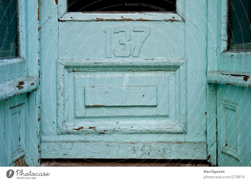 Old Blue Wood Building Glass Door Derelict Shabby Light blue House number Scratched Front door Frame and panel door