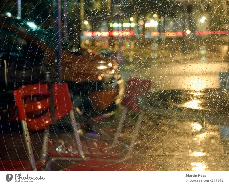 Dark Berlin Car Rain Weather Wet Drops of water City life Chair Gastronomy Café Window pane Bad weather Night life Kreuzberg Multicoloured