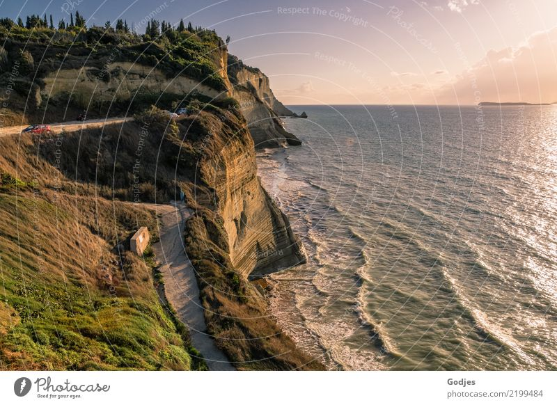 View of the wooded cliffs of Logas Beach, Corfu Nature Landscape Earth Water Sky Clouds Horizon Summer Tree Grass Bushes Forest Rock Waves coast