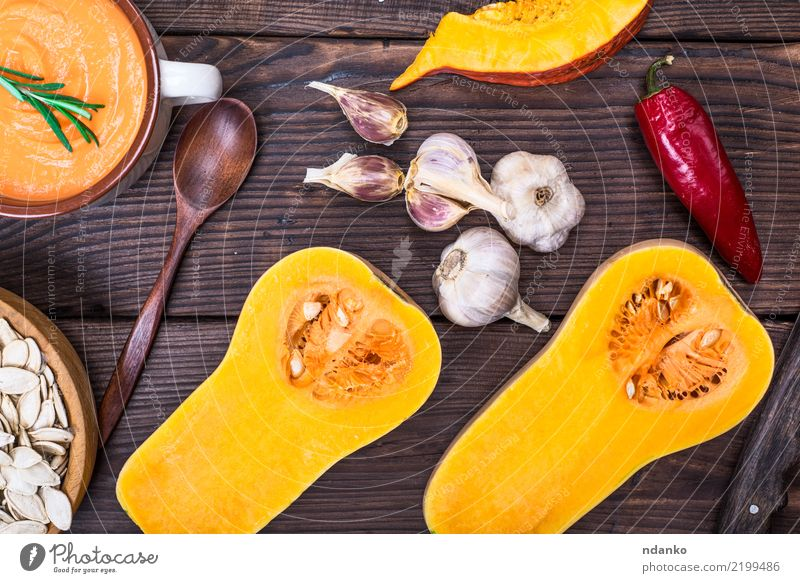 fresh pumpkin cut in half Vegetable Soup Stew Eating Dinner Organic produce Vegetarian diet Diet Bowl Spoon Decoration Table Hallowe'en Nature Autumn Wood Fresh