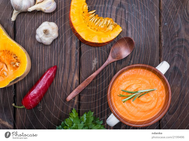 creamy pumpkin soup Vegetable Soup Stew Herbs and spices Eating Lunch Dinner Vegetarian diet Bowl Spoon Table Hallowe'en Autumn Wood Fresh Above Brown Yellow