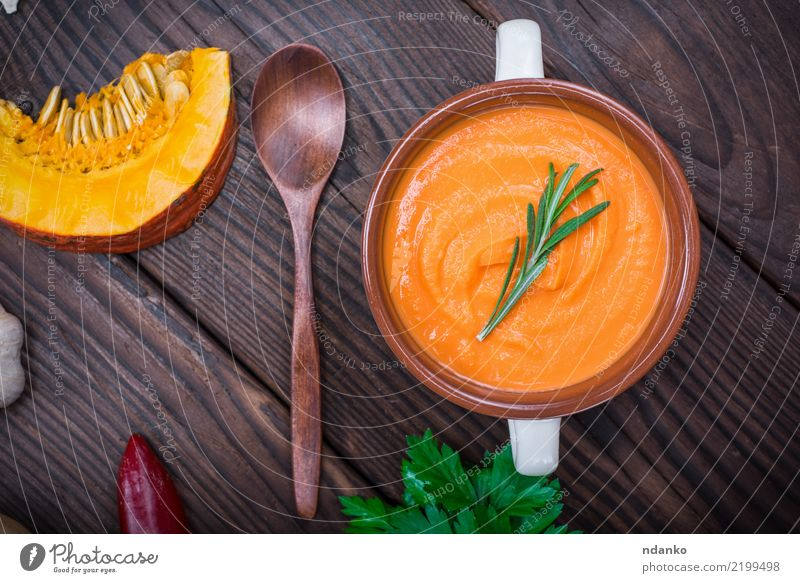 creamy pumpkin soup Healthy Eating Green Yellow Autumn Wood Brown Above Fresh Table Herbs and spices Vegetable Seasons Bowl Dinner Diet