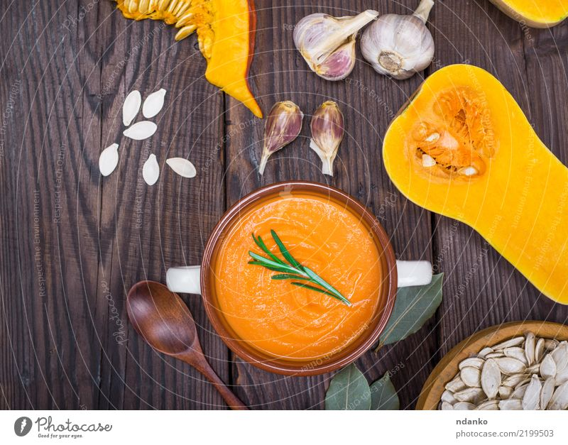 pumpkin soup in a ceramic plate Eating Yellow Autumn Wood Health care Brown Above Fresh Table Vegetable Seasons Organic produce Bowl Dinner Vegetarian diet