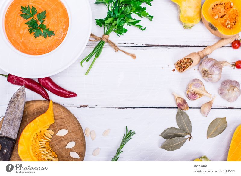 creamy pumpkin soup Vegetable Soup Stew Herbs and spices Eating Lunch Dinner Organic produce Vegetarian diet Plate Bowl Knives Healthy Eating Decoration Table