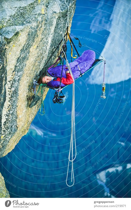 Rock climber sleeping on a clfff. Human being Adults Sports Tall Adventure Rope Climbing Athletic Brave Risk Balance Fear of heights Attempt Vertical Mountaineering Self-confident