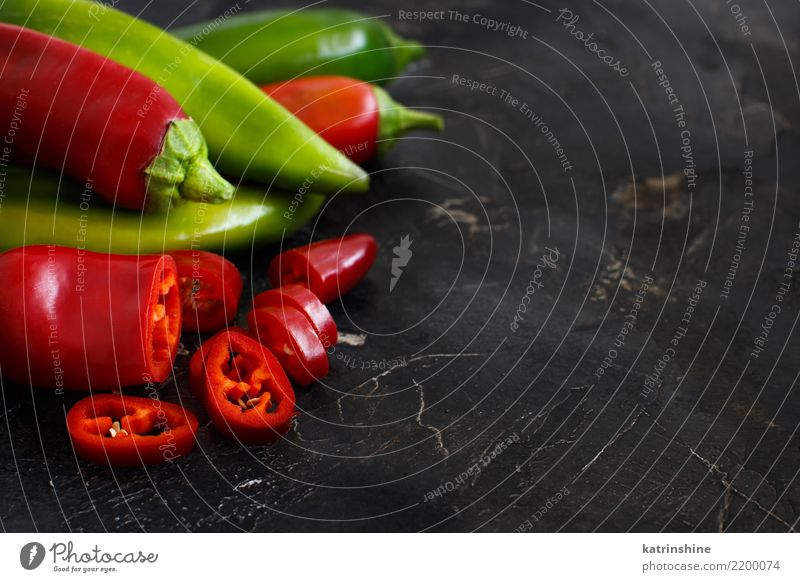Red and green sweet peppers on dark background Colour Green White Natural Group Nutrition Fresh Table Vegetable Diet Vegetarian diet Raw Ingredients Organic