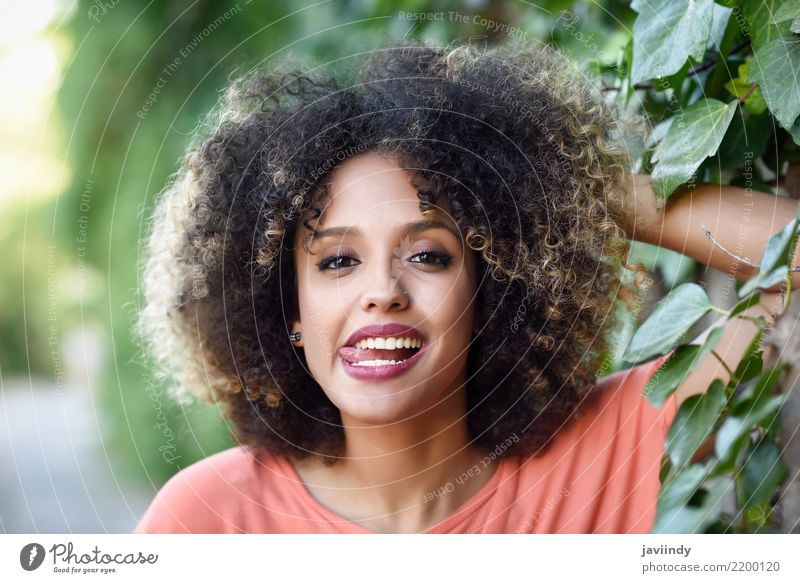 Black woman with tongue out in an urban park Lifestyle Style Joy Happy Beautiful Hair and hairstyles Face Human being Woman Adults Fashion Afro Smiling