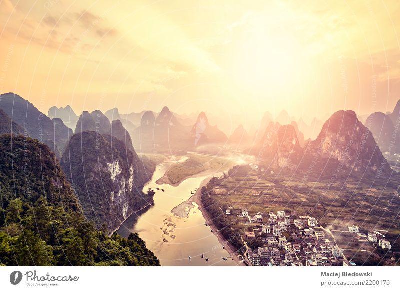 Lijiang River at sunset, China. Vacation & Travel Sun Landscape Far-off places Mountain Tourism Freedom Trip Adventure Peak Village Asia Experience Guilin