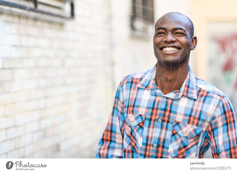 Black man very happy, smiling in urban background Happy Beautiful Human being Man Adults Street Clothing Shirt Smiling Modern Self-confident african American