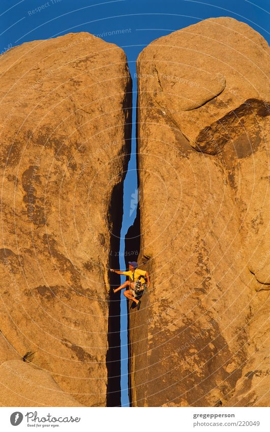 Climber clinging to a cliff. Adventure Sports Climbing Mountaineering Rope Man Adults 1 Human being Athletic Tall Self-confident Determination Loneliness Effort