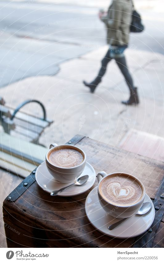 show window Beverage Coffee Cup Spoon Human being Feminine Young woman Youth (Young adults) 1 Brown Gray Pedestrian Cappuccino Heart Chest Sidewalk Bench