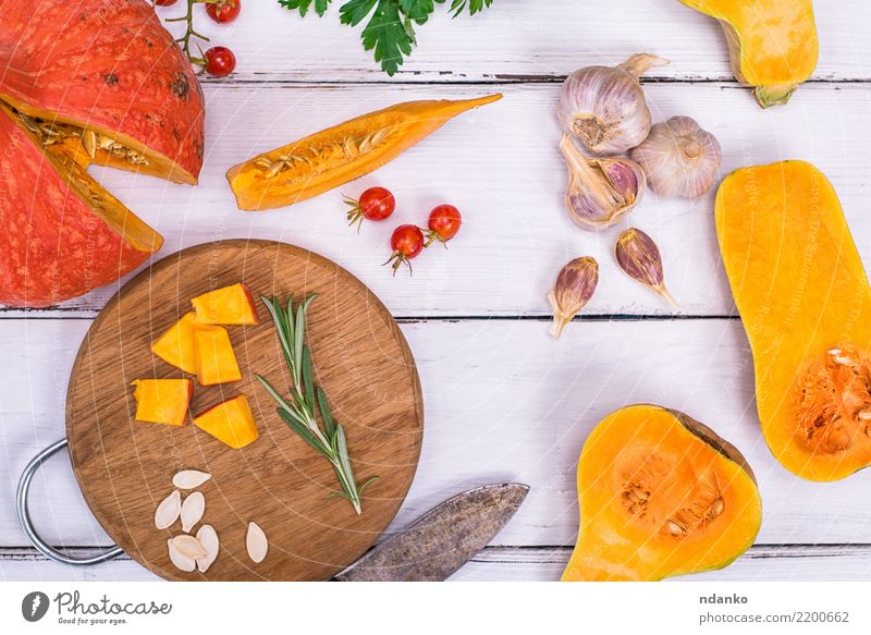 ripe pumpkin sliced in pieces Nature Healthy Eating White Yellow Autumn Natural Wood Nutrition Fresh Table Vegetable Seasons Harvest Organic produce Tradition