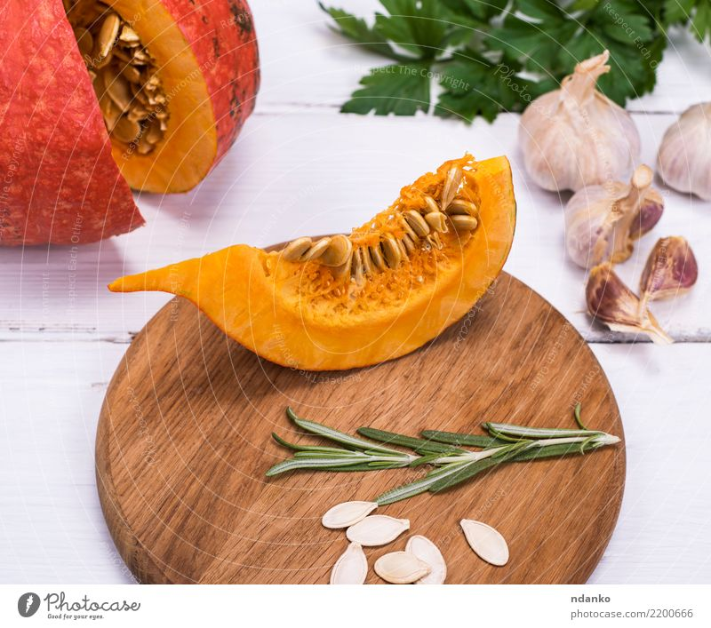 piece of fresh pumpkin with seeds Nature Eating Yellow Autumn Wood Decoration Fresh Table Vegetable Seasons Harvest Tradition Dinner Meal Vegetarian diet
